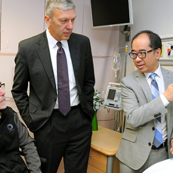 Dr. Chester Ho, right, demonstrates how the XSENSOR technology works, with Dr. Bill Ghali, centre, and Clay Richardson, left, who himself has experienced severe bed sores. Photo by Bruce Perrault, University of Calgary