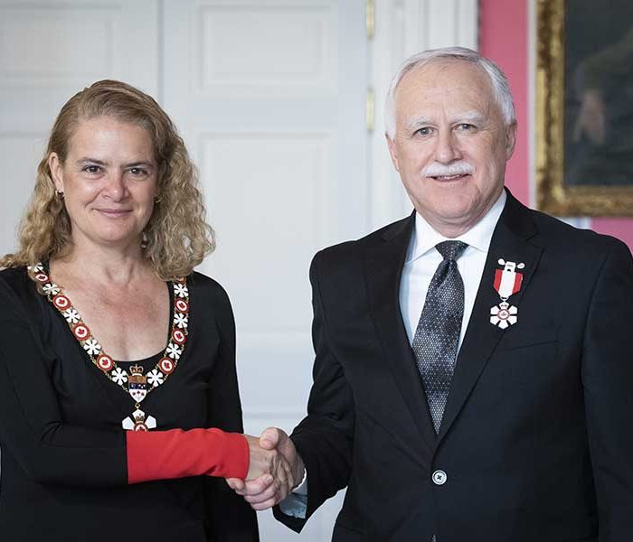 Governor General Julie Payette invests University of Calgary professor John Conly as a member of the Order of Canada